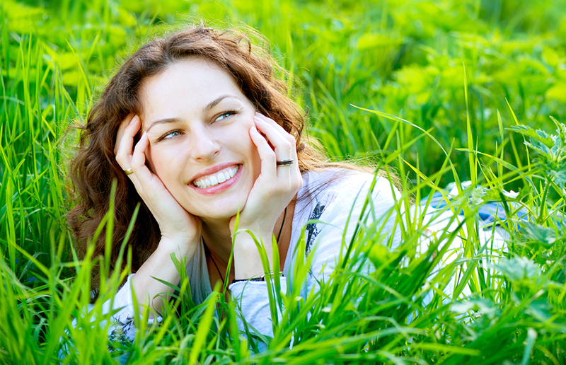 Image of Woman Smiling In Meadow