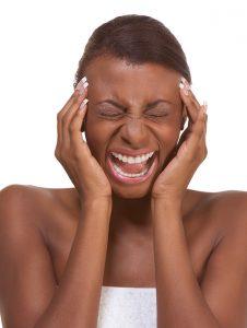 Image of woman suffering migraine headache